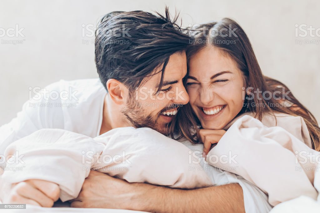 Lovely affectionate couple in the bed royalty-free stock photo