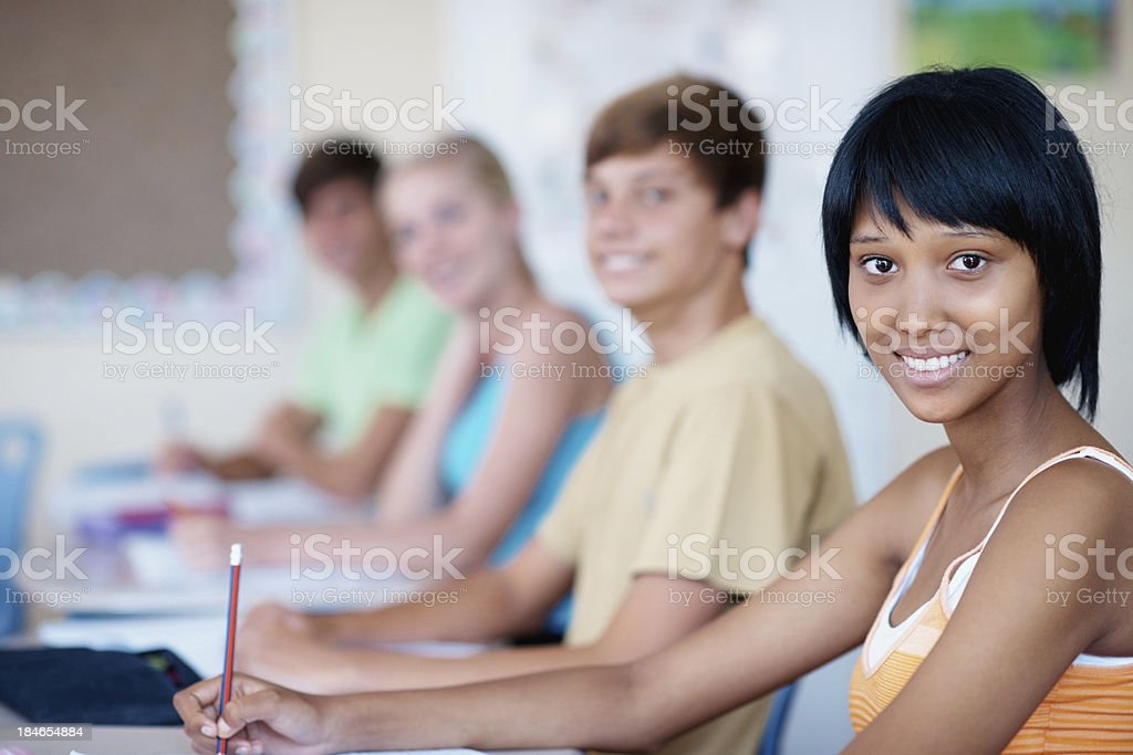 Lovely African American student with classmates royalty-free stock photo