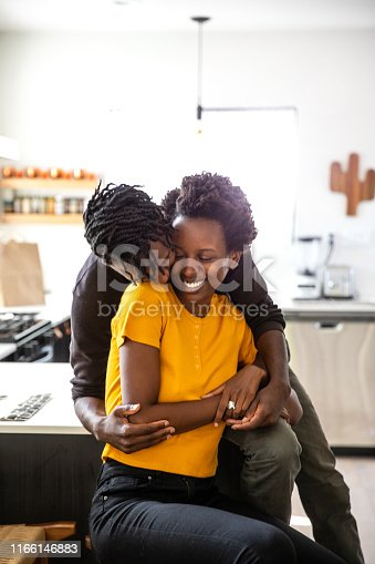 Lovely afro american couple spending happy time together at home