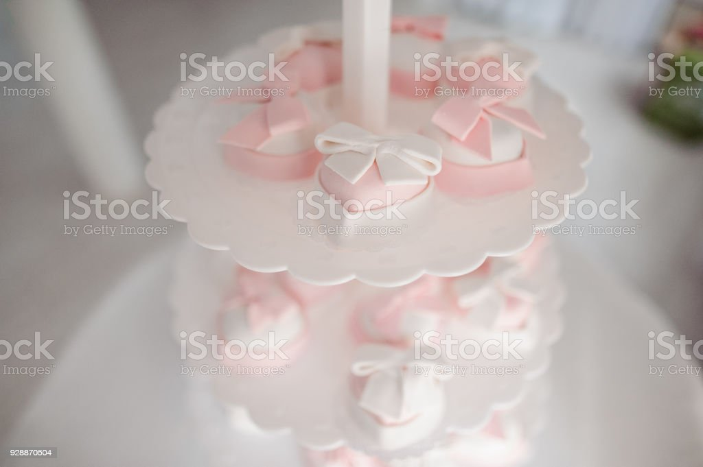 Lovely and tasty cakes in white and pink tones stock photo