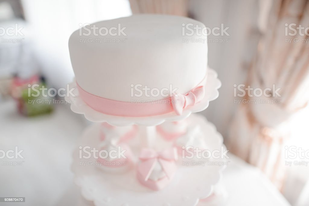 Lovely and tasty white and pink cake stock photo