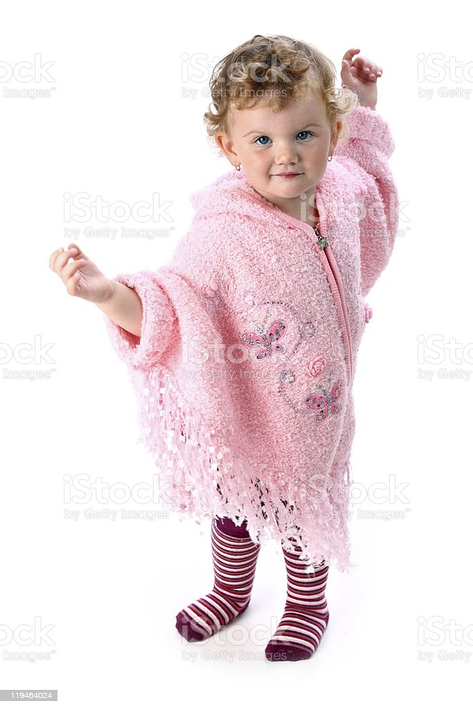 Lovely Baby Girl Dancing In Pink Poncho Isolated On White