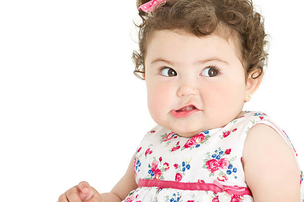 Lovely baby girl making a face stock photo