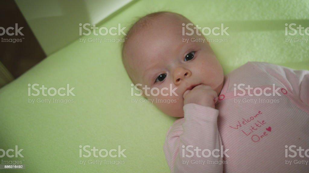 Lovely Baby Sucks Her Finger close-up stock photo