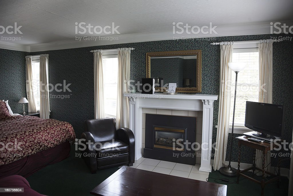 Lovely bedroom in old fashioned bed and breakfast royalty-free stock photo