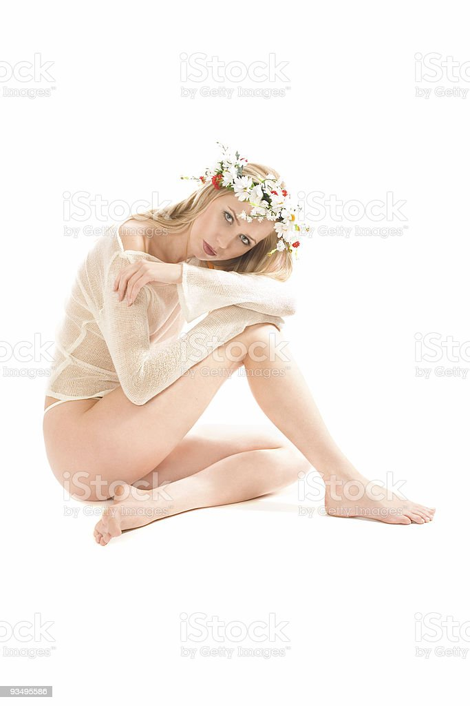 Lovely blond in trasparent shirt and wreath on head royalty-free stock photo
