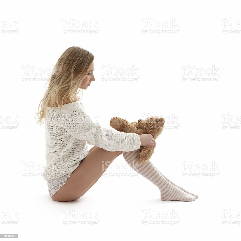 lovely blond in white sweater with teddy bear #2 royalty-free stock photo