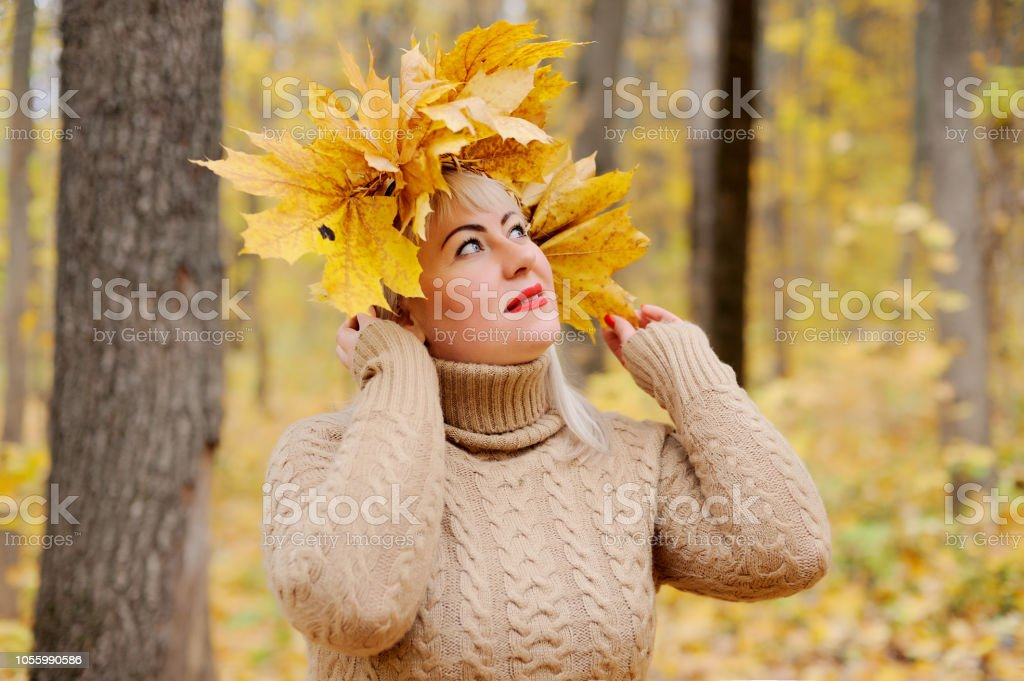 A lovely blonde woman of large size in a wreath of yellow autumn...