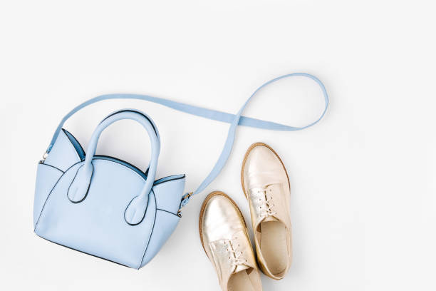 lovely blue ladies bag and stylish golden shoes. flat lay, top view. spring fashion concept - spring fashion stock pictures, royalty-free photos & images