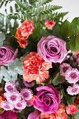 Close up of beautiful bridal spring multi colored bouquet,  Or, arrangement of roses, carnations, and mini chrysanthemum flowers.