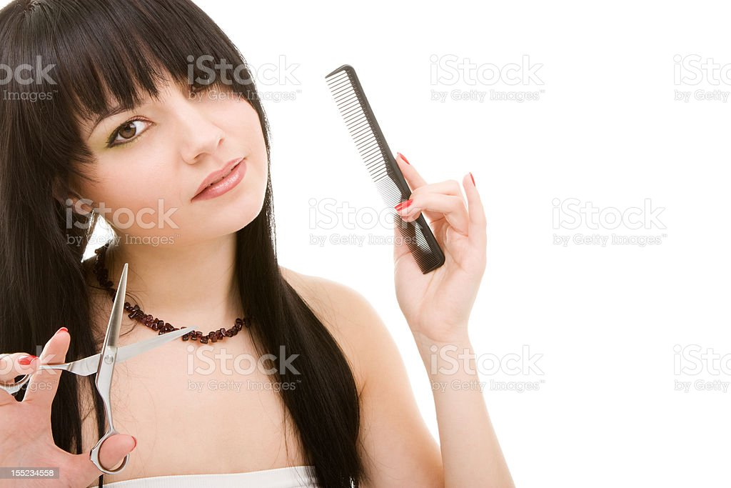 Lovely brunette with scissors of the hairdresser royalty-free stock photo