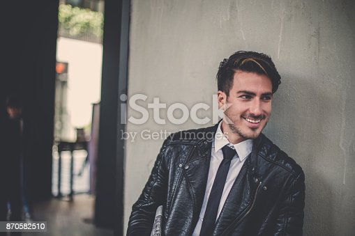istock Lovely businessman with newspaper in his hand 870582510