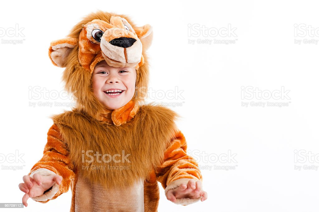 Lovely child dressed up in a lion costume stock photo