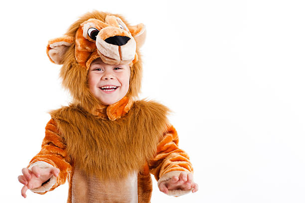 Lovely child dressed up in a lion costume Happy little girl dressed up in lion costume for carnival (space for text) carnival children stock pictures, royalty-free photos & images