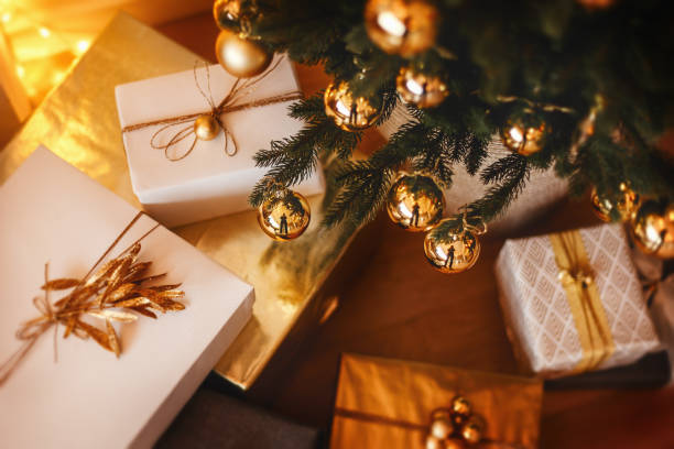 Lovely christmas tree with beautifuly packed presents boxes under it stock photo