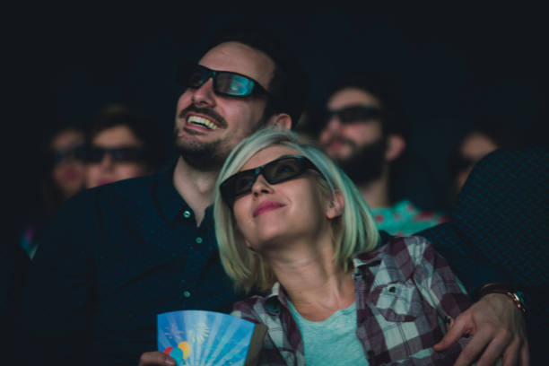 Lovely couple at the cinema and 3d movie projection stock photo