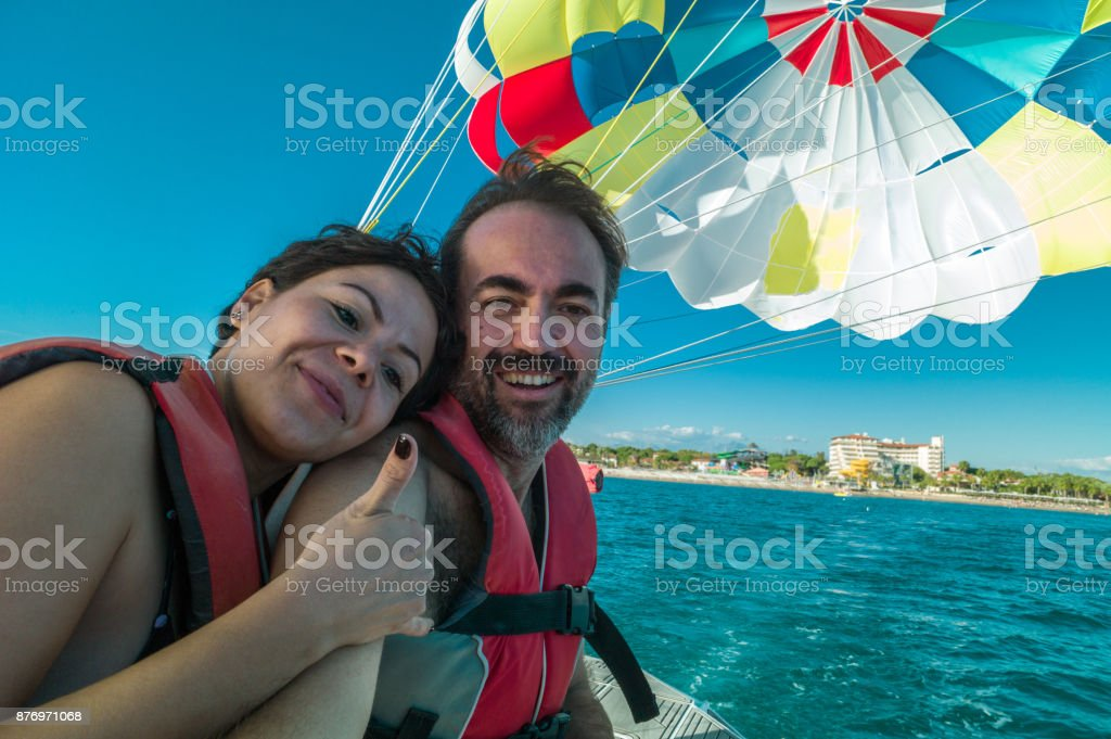 Lovely couple before parasailing stock photo