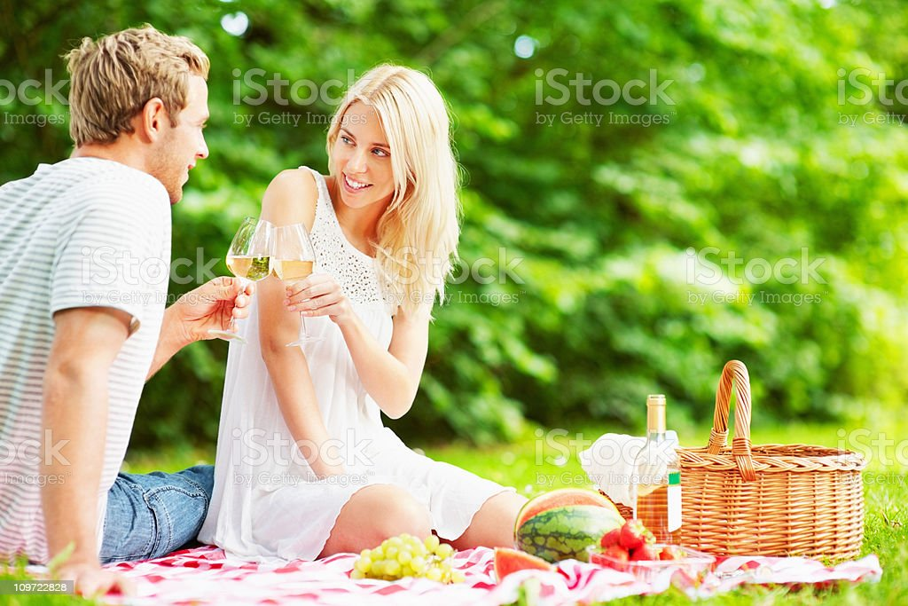 Lovely couple celebrating together with champagne at picnic royalty-free stock photo