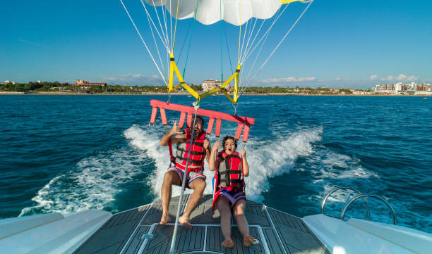 Lovely couple during parasailing stock photo