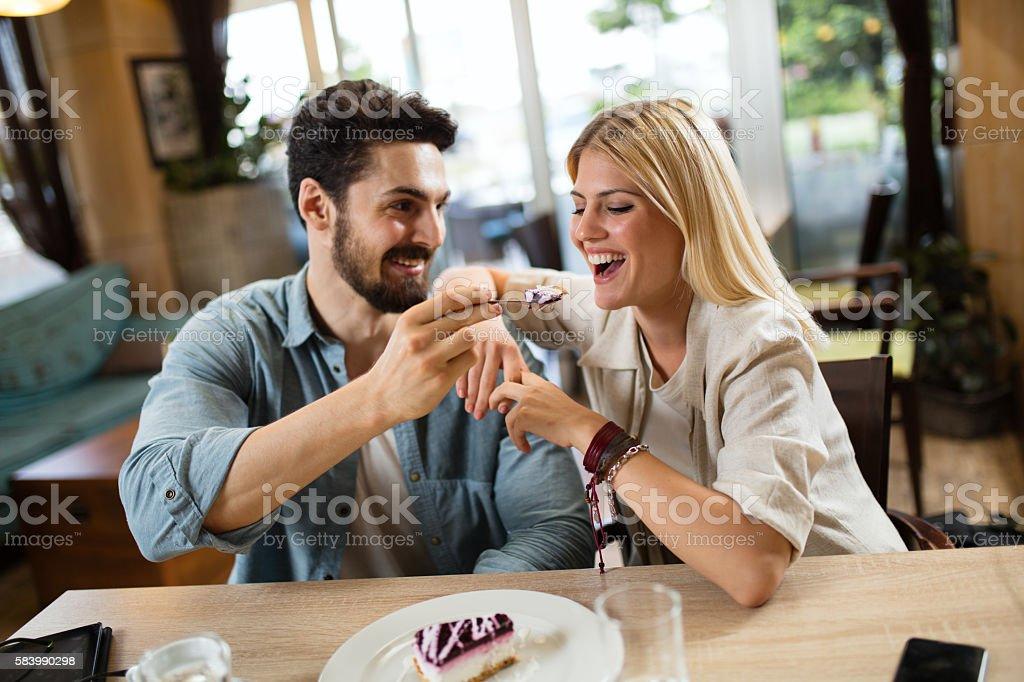 Lovely couple enjoying dessert in cafe . stock photo