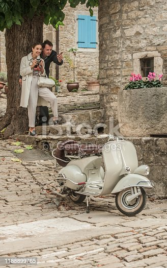 Lovely Couple, Elegant Dressed, Having Fun Riding Vintage Scooter in Old  Medieval Town Village of Grožnjan, also Called City of Artist, in Croatia's Istria County