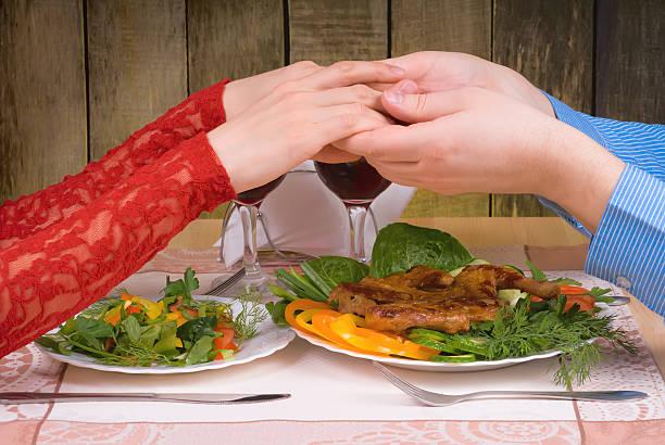 Lovely couple having romantic dinner stock photo