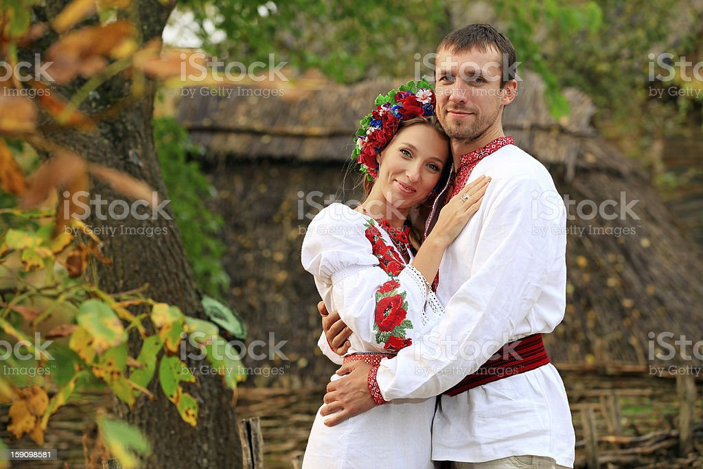 Lovely couple in Ukrainian national costumes outdoors royalty-free stock photo