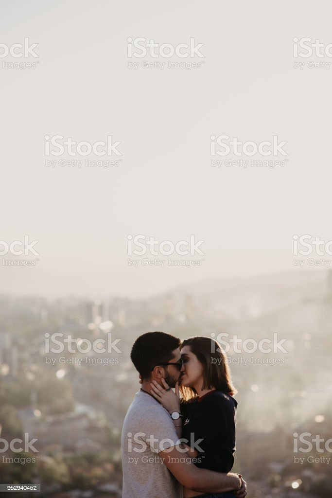 Lovely couple kissing each other and enjoying a nice summer day in...