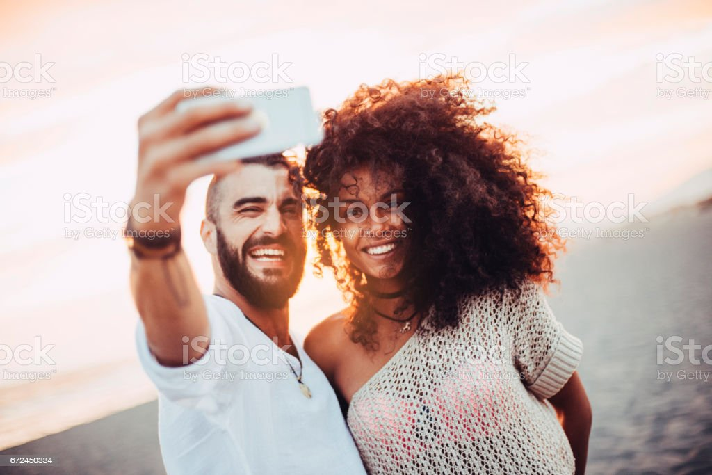 Lovely couple making a selfie stock photo