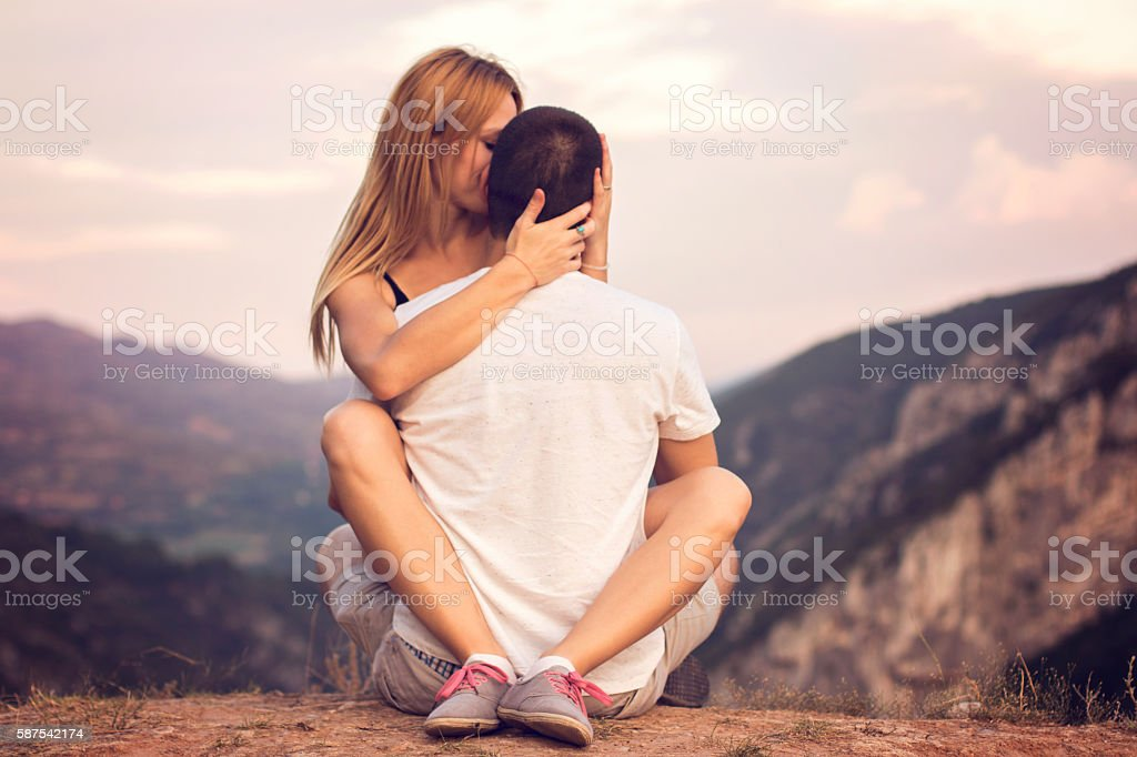 Lovely Couple On Top Of The Mountain Stock Photo Download Image