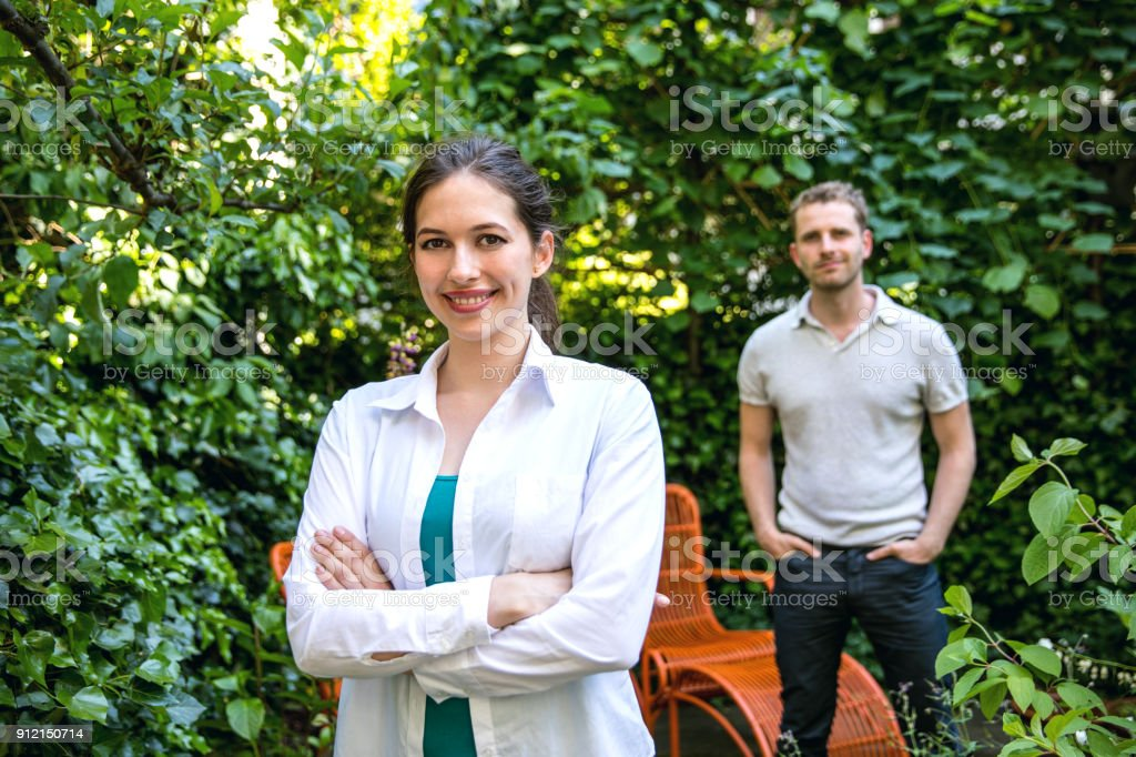 Lovely couple posing in their beautiful garden at home