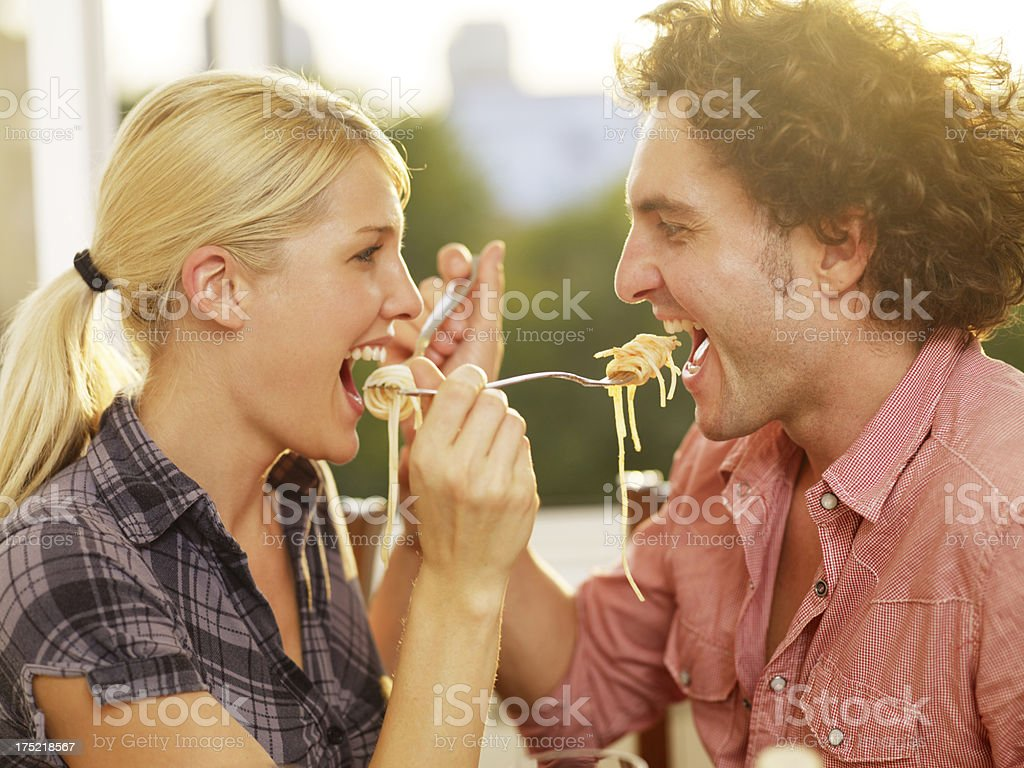 Lovely Couple Sharing Spaghetti stock photo