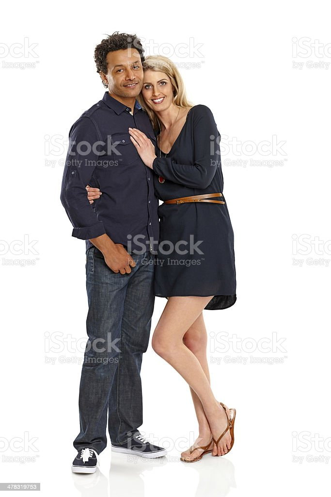 Lovely couple standing together over white royalty-free stock photo