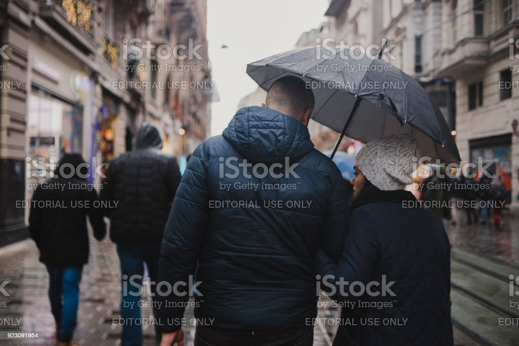 Lovely couple walking with love in streets of Istanbul stock photo