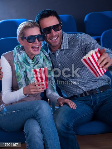 187095683 istock photo Lovely couple watching a 3d movie 179041571