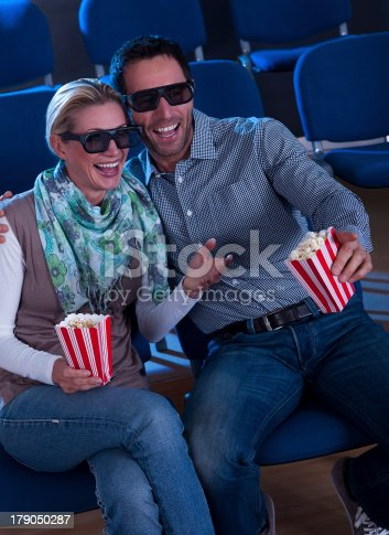187095683 istock photo Lovely couple watching a 3d movie 179050287