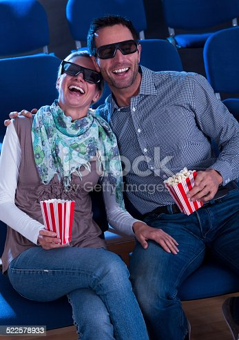187095683 istock photo Lovely couple watching a 3d movie 522578933