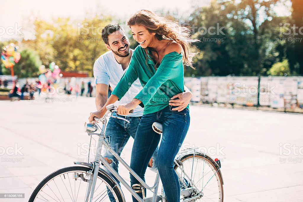 Lovely couple with a bike stock photo
