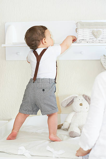 Lovely cute babyboy playing at home and having nice time stock photo