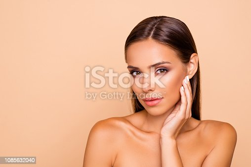 Lovely cute good-looking sweet gorgeous nice stunning adorable lady with shoulders she isolated on pastel beige background with copy space for text look at camera touch her cheek by hand