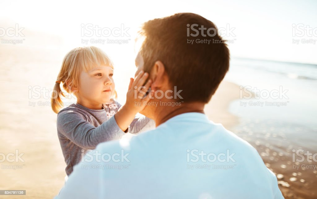lovely daughter kiss the dad stock photo