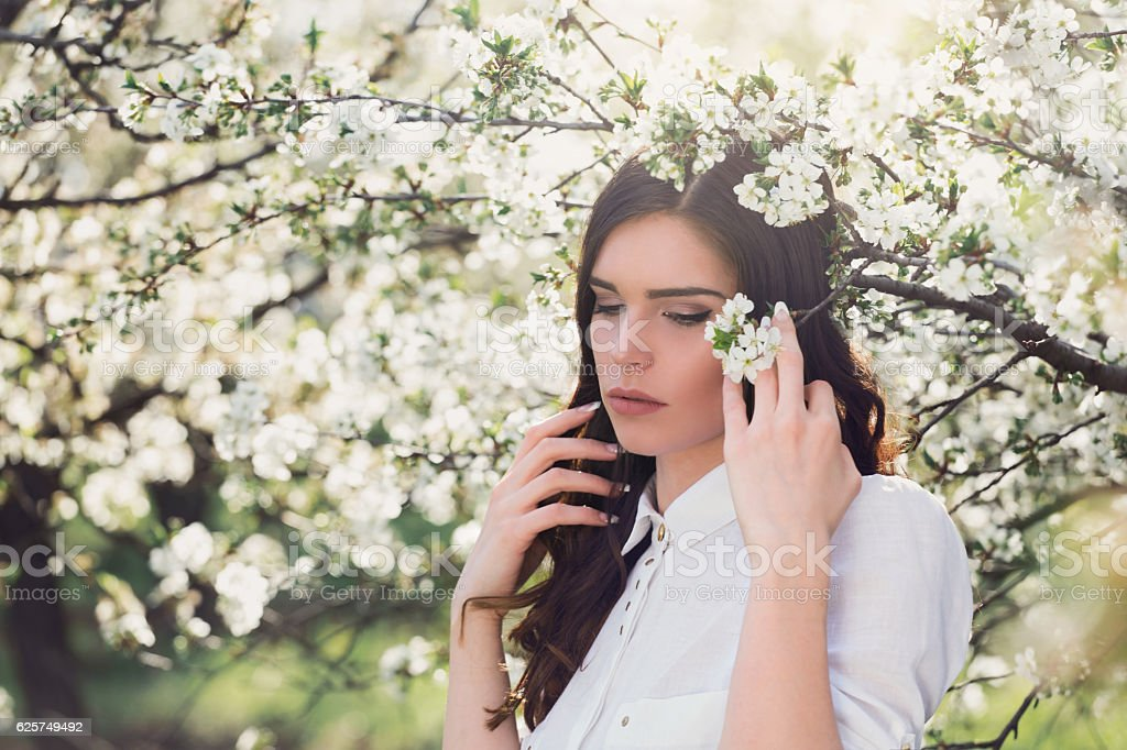 Portrait of a beautiful young woman in spring.