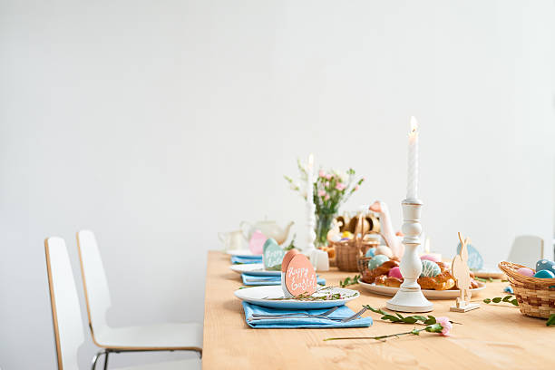 lovely decorated easter table - osterdekoration stock-fotos und bilder