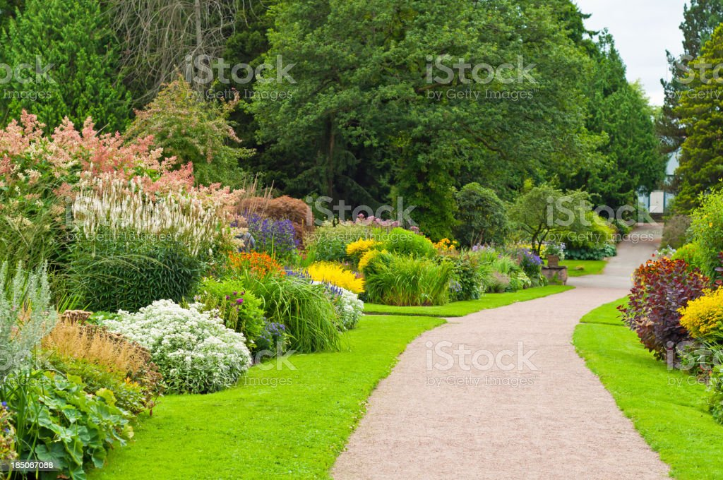 Lovely garden with footpath. stock photo