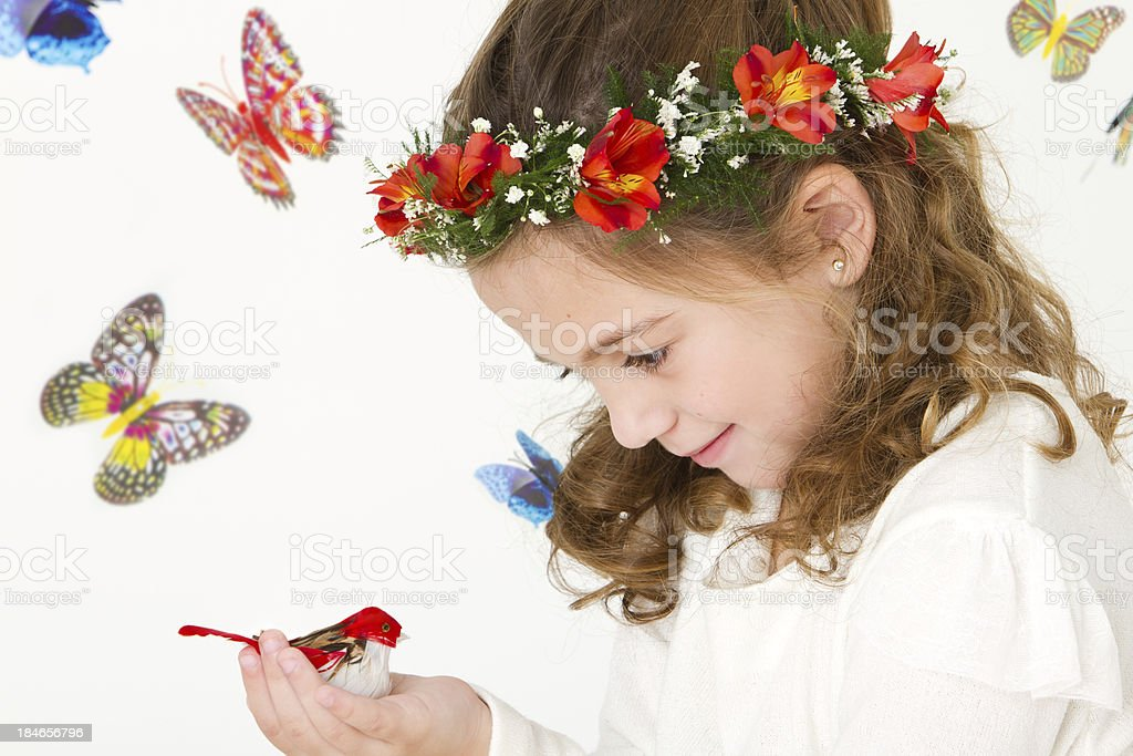 Lovely girl with bird and butterflies royalty-free stock photo