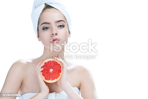 532331272 istock photo Lovely girl with pomelo slice 522643096