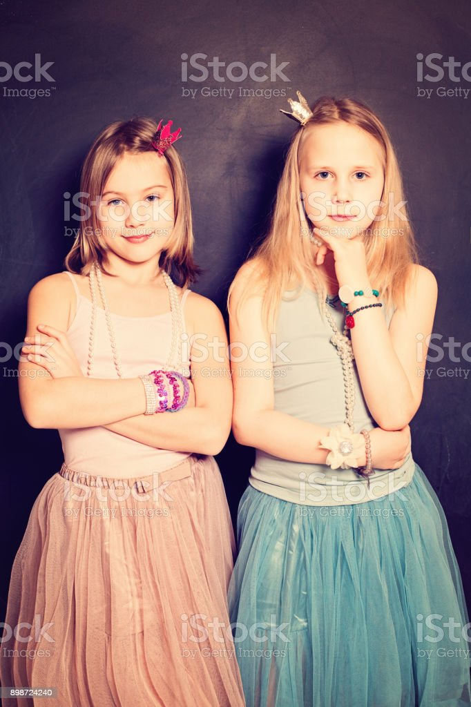 Lovely Girls Sisters. Two Cute Young Teen Girls Friends - Stock image .