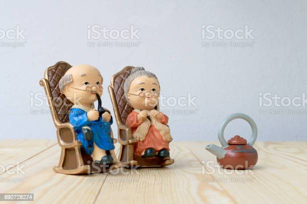 Lovely grandparent doll siting old sofa classic chair together on picture id692728274?b=1&k=6&m=692728274&s=612x612&h=sqf7sshosya9nwnmsrl dy59wxfr3d92qm9nvla7vto=