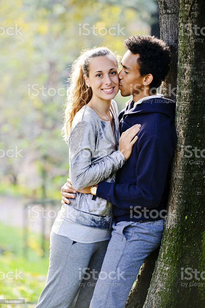 Lovely interracial couple having great time outdoors royalty-free stock photo