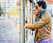 istock Lovely interracial couple Looking at shop window display 160187874